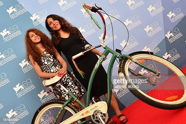 Director Haifaa Al Mansour and actress Waad Mohammed pose during the photocall of Wadjda at the 69th Venice Film Festival on August 31 2012 at Venice...