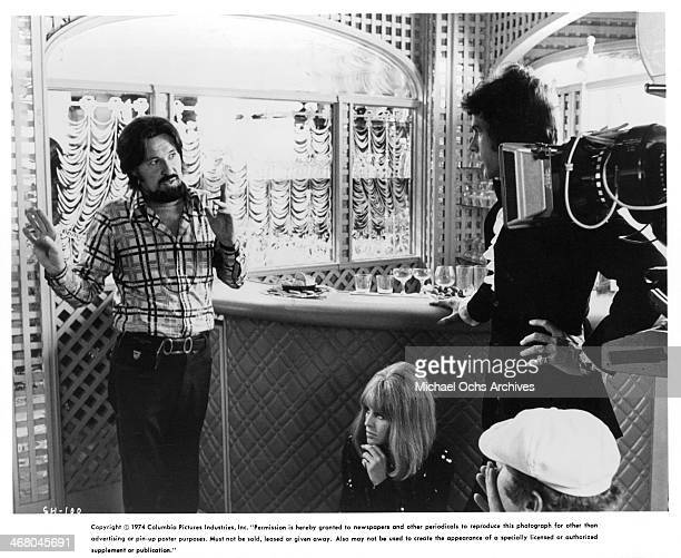 Director Hal Ashby directs Warren Beatty on set of the movie 'Shampoo' circa 1975