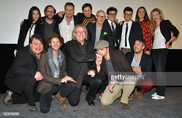 Director Hans Hofer, producer Danny Krausz and the filmcrew pose on stage during the after party for the premiere of 'Zweisitzrakete' at Technisches...