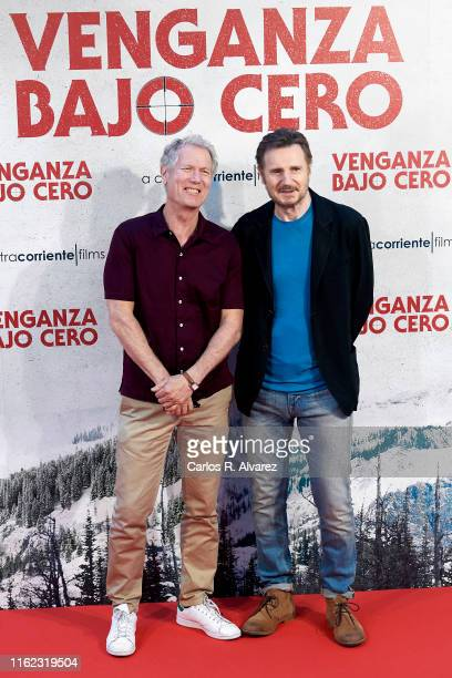 Director Hans Petter Moland and actor Liam Neeson attend 'Venganza Bajo Cero' photocall at the Villamagna Hotel on July 16 2019 in Madrid Spain