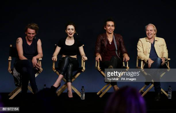 Director Harald Zwart with cast members of the film The Mortal Instruments City of Bones Jamie Campbell Bower Lily Collins and Robert Sheehan during...