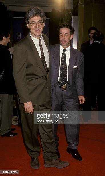 Director Harold Ramis and Mark Canton attend the premiere of 'Groundhog Day' on February 4 1993 at Mann Village Theater in Westwood California