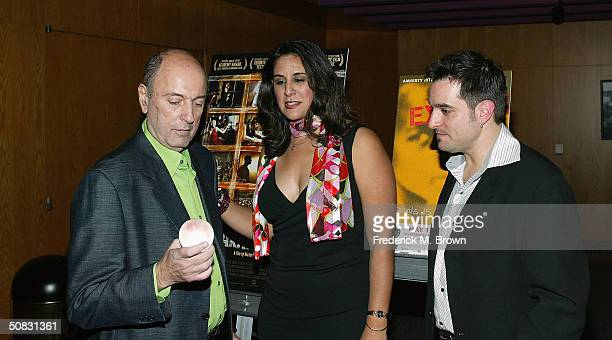 Director Hector Babenco Bonnie Abaunza director of Artist for Amnesty and Dennis Palmieri public relations officer attend the premiere screening of...