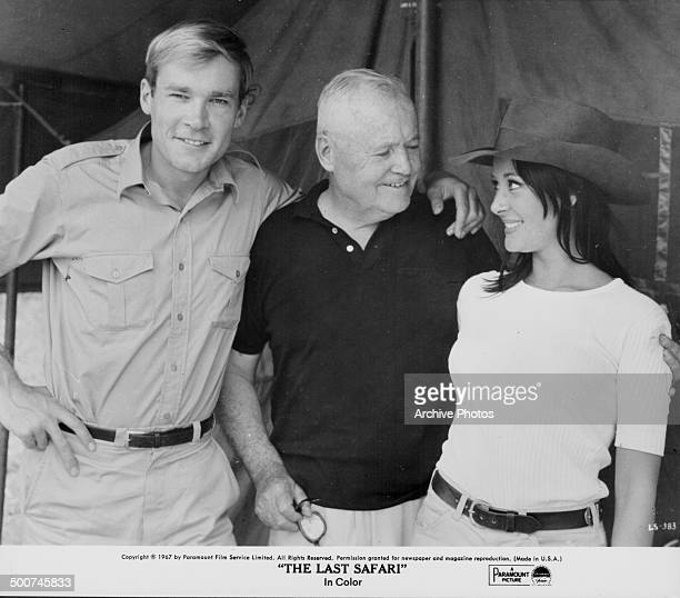 Director Henry Hathaway with actors Gabriella Licudi and Kaz Garas on the set of the movie 'The Last Safari' 1967