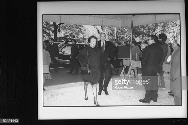Director Herbert Ross and wife socialite Lee Radziwill entering temple for William S Paley's funeral