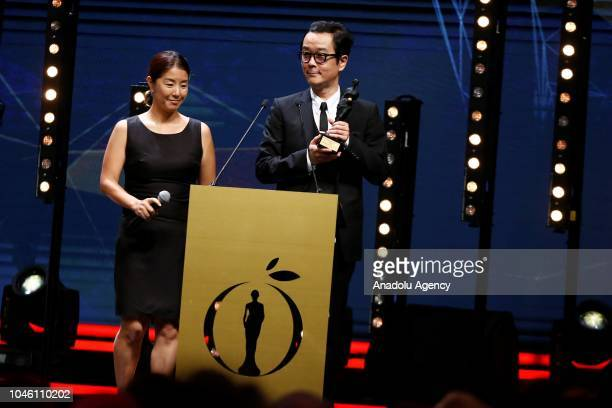 Director Hirokazu Koreeda accompanied by actress Lily Franky receives the Best Director award with his film 'Shoplifters' during the 55th Antalya...
