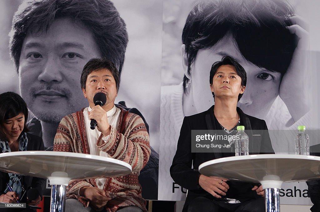 Director Hirokazu Kore-Eda and actor Masahara Fukuyama attend an open talk during the 18th Busan International Film Festival on October 4, 2013 in Busan, South Korea.