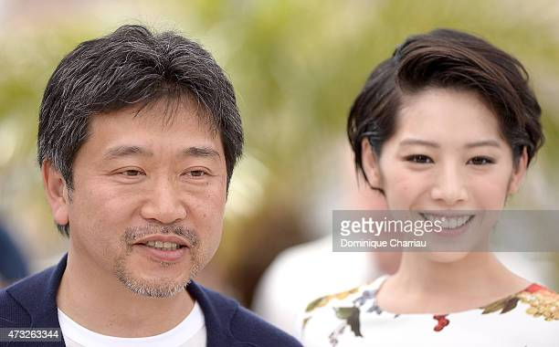 Director Hirokazu Koreeda and actress Kaho attend the 'Umimachi Diary' photocall during the 68th annual Cannes Film Festival on May 14 2015 in Cannes...