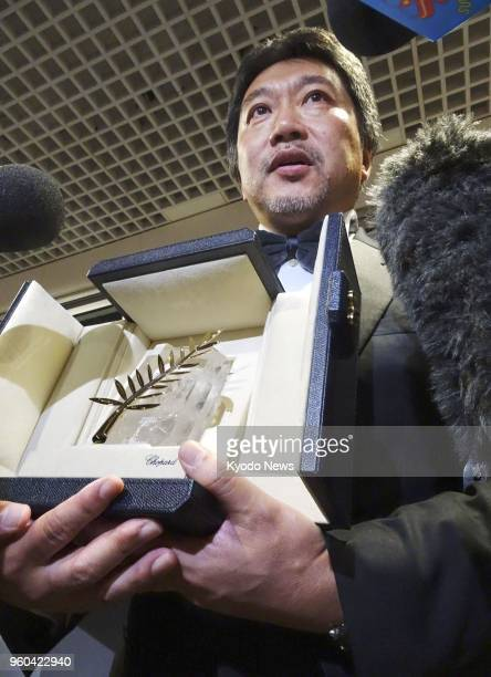 Director Hirokazu Koreeda meets with reporters after receiving the Palme d'Or award for his work 'Shoplifters' at the annual Cannes International...