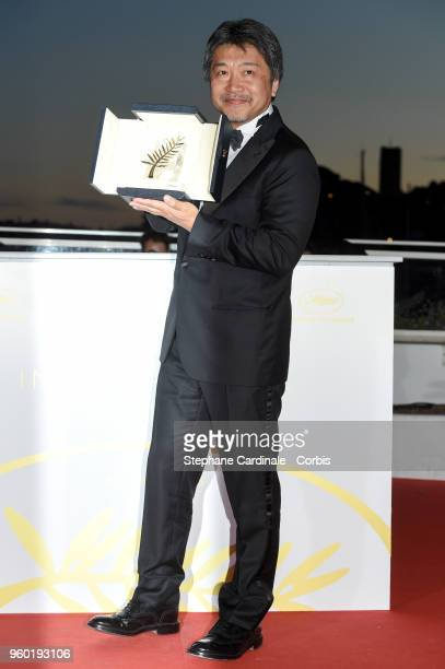 Director Hirokazu Koreeda poses with the Palme d'Or award for 'Shoplifters' at the Palme D'Or Winner Photocall during the 71st annual Cannes Film...