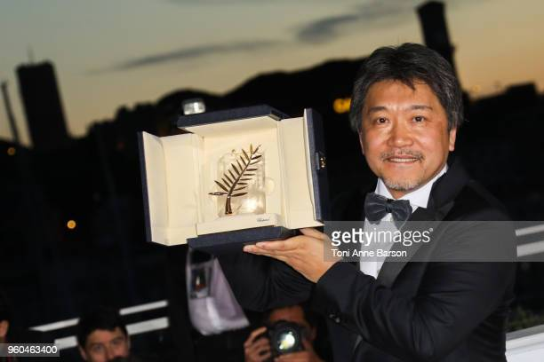 Director Hirokazu Koreeda poses with the Palme d'Or award for 'Shoplifters' at the photocall the Palme D'Or Winner during the 71st annual Cannes Film...