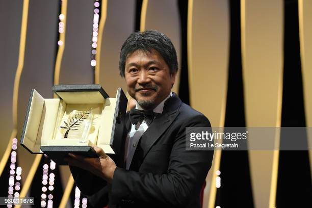 Director Hirokazu Koreeda receives the Palme d'Or award for 'Shoplifters' on stage during the Closing Ceremony at the 71st annual Cannes Film...