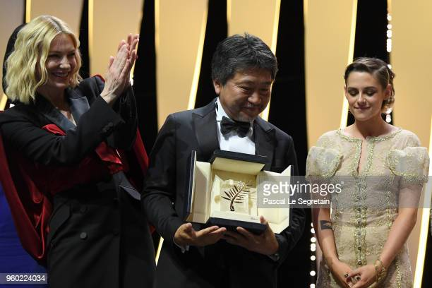 Director Hirokazu Koreeda winner of the Palme d'Or award for 'Shoplifters' pose on stage with jury poresident Cate Blanchett and jury member Kristen...