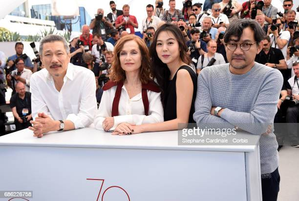 Director Hong SangSoo Actresses Isabelle Huppert and Kim Minhee and a guest attend the Claire's Camera photocall during the 70th annual Cannes Film...