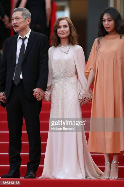 Director Hong SangSoo Isabelle Huppert and Kim Minheet of 'Claire's Camera ' walk the red carpet ahead of the 'The Meyerowitz Stories' screening...