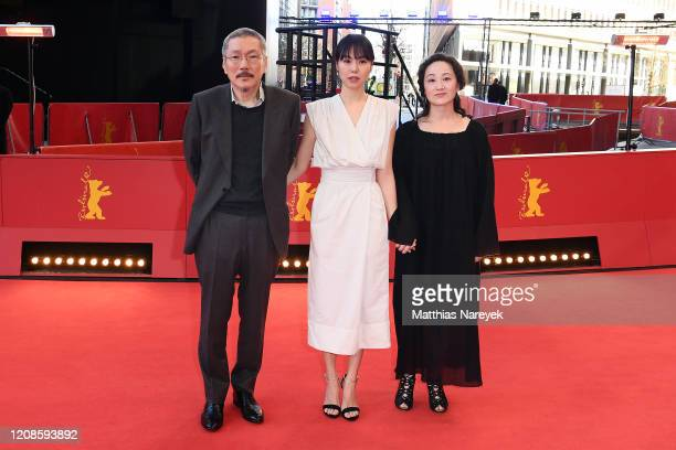 Director Hong Sangsoo Kim Minhee and Seo Younghwa pose at the The Woman Who Ran premiere during the 70th Berlinale International Film Festival Berlin...