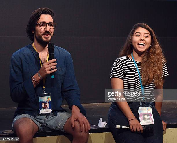 Director Ilker Catak and programming assistant at the Palm Springs International ShortFest Kelanie Aragon Silva do a QA at the 2015 Palm Springs...