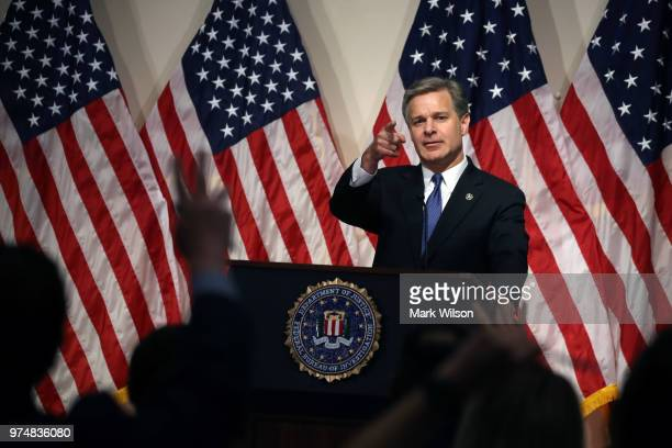 Director is Christopher A Wray speaks to the media during a news conference at FBI Headquarters on June 14 2018 in Washington DC Earlier today the...
