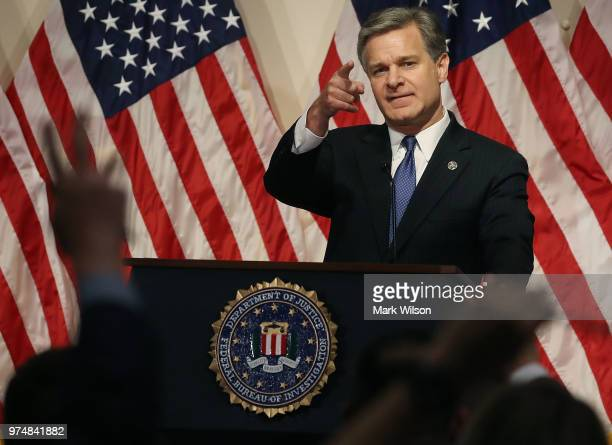 Director is Christopher A. Wray speaks to the media during a news conference at FBI Headquarters, on June 14, 2018 in Washington, DC. Earlier today...