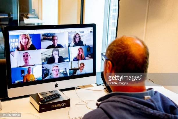 Director is seen having an online meeting with his employees through a laptop on zoom video call app. The Dutch government has ordered all offices to...