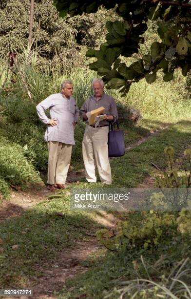 Director Ismail Merchant discussing filming with Director James Ivory while filming 'The Mystic Masseur' in Trinidad in October 2001