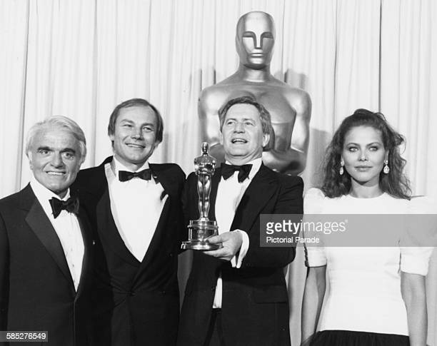 Director Istvan Szabo holds his Best Foreign Language Film Oscar for the film 'Mephisto' with his lead actor Klaus Maria Brandauer and the award...