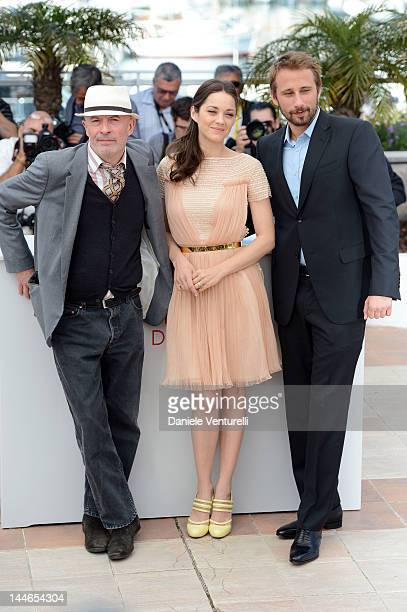 """Director Jacques Audiard and actors Marion Cotillard and Matthias Schoenaerts attend the """"De Rouille et D'os"""" Photocall during the 65th Annual Cannes..."""