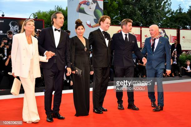 director Jacques Audiard screenwriter Thomas Bidegain actor John C Reilly his wife producer Alison Dickey composer Alexandre Desplat and his wife...