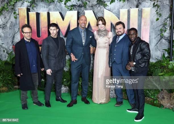 Director Jake Kasdan Nick Jonas Dwayne Johnson Karen Gillan Jack Black and Kevin Hart attend the UK premiere of 'Jumanji Welcome To The Jungle' at...