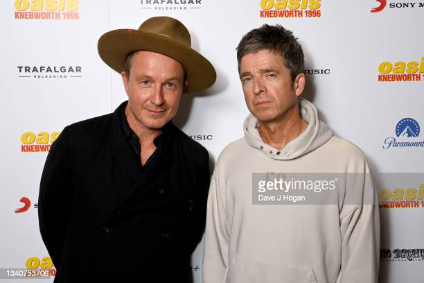 """Director Jake Scott and Noel Gallagher attend """"Oasis Knebworth 1996"""" World Premiere at Picturehouse Central on September 16, 2021 in London, England."""