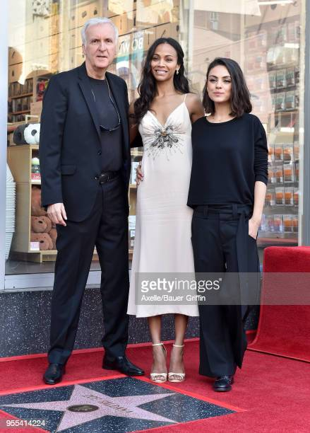 Director James Cameron actors Zoe Saldana and Mila Kunis attend the ceremony honoring Zoe Saldana with star on the Hollywood Walk of Fame on May 3...