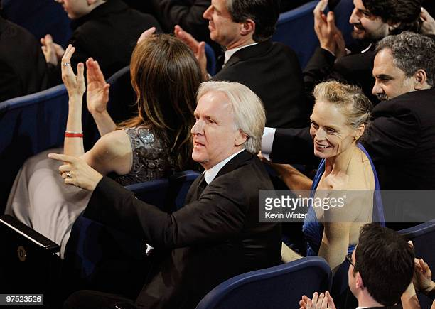 Director James Cameron and wife actress Suzy Amis applaud from the audience during the 82nd Annual Academy Awards held at Kodak Theatre on March 7...