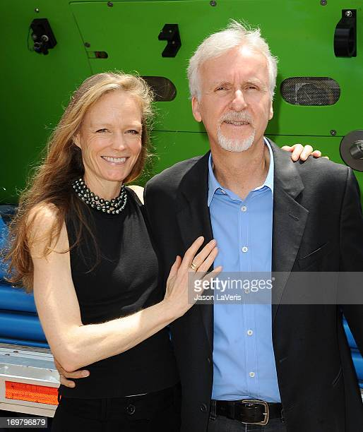 Director James Cameron and wife Suzy Amis attend the Deepsea Challenger photocall at California Science Center on June 1 2013 in Los Angeles...