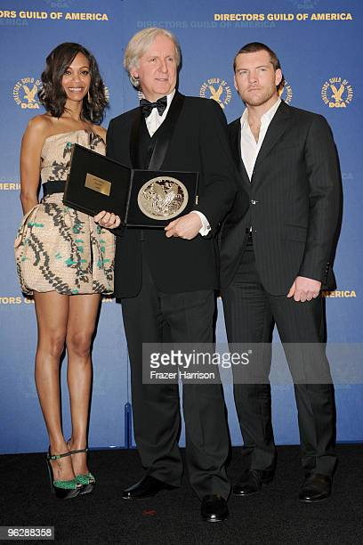 Director James Cameron poses with his Feature Film Nomination Plaque for 'Avatar' with actors Zoe Saldana and Sam Worthington in the press room...