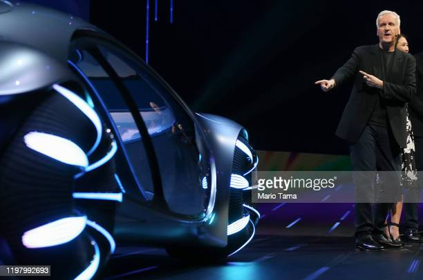 Director James Cameron who directed 'Avatar' gestures towards the MercedesBenz Vision AVTR concept car an 'Avatar'themed vehicle at a keynote address...