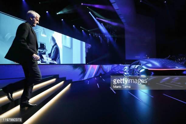 Director James Cameron who directed 'Avatar' walks towards the MercedesBenz Vision AVTR concept car an 'Avatar'themed vehicle at a keynote address at...