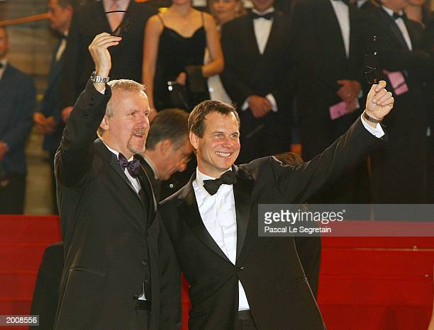 """Director James Cameron with Actor Bill Paxton arrive for the screening of the film """"Ghosts of the Abyss"""" at the Palais des Festivals during the 56th..."""