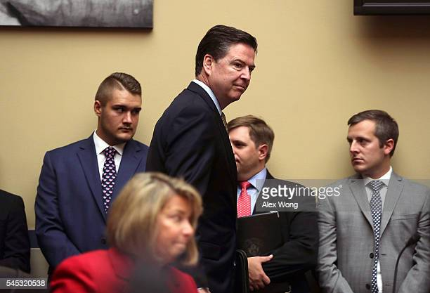 Director James Comey arrives at a hearing before House Oversight and Government Reform Committee July 7 2016 on Capitol Hill in Washington DC The...