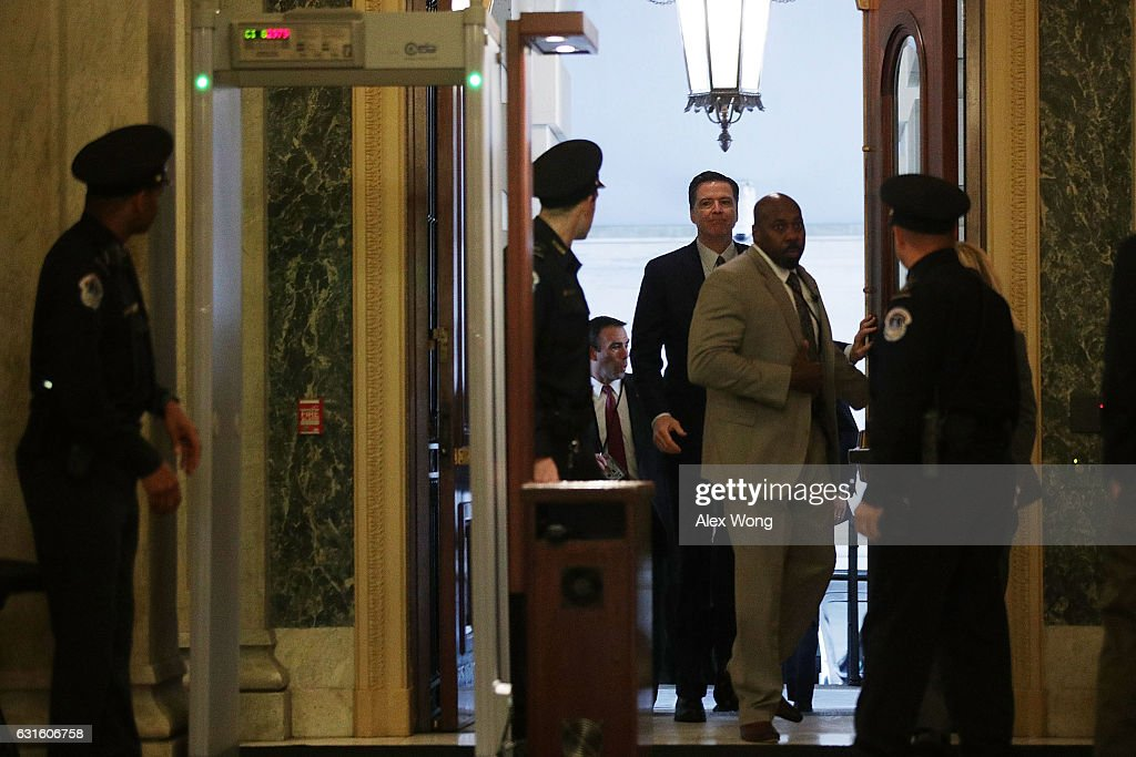 Director James Comey (C) arrives at the U.S. Capitol for a classified briefing on Russia for all members of the House of Representatives January 13, 2017 on Capitol Hill in Washington, DC. The internal Office of the Inspector General at the Justice Department announced yesterday that it is conducting a review on the handling of FBI and DOJ's investigation into the Hillary Clinton private e-mail server case.