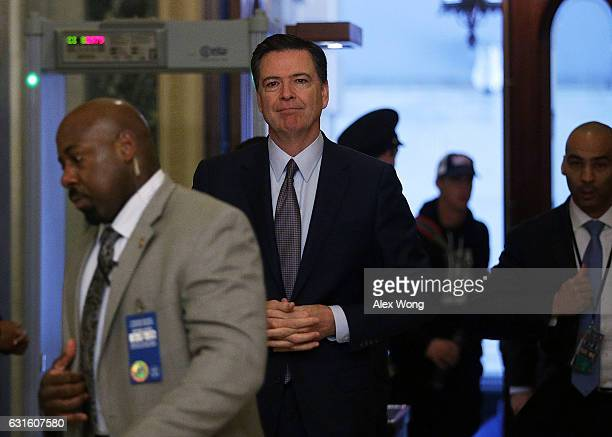 Director James Comey arrives at the US Capitol for a classified briefing on Russia for all members of the House of Representatives January 13 2017 on...