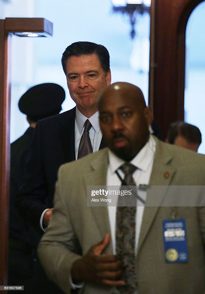 Director James Comey (L) arrives at the U.S. Capitol for a classified briefing on Russia for all members of the House of Representatives January 13, 2017 on Capitol Hill in Washington, DC. The internal Office of the Inspector General at the Justice Department announced yesterday that it is conducting a review on the handling of FBI and DOJ's investigation into the Hillary Clinton private e-mail server case.