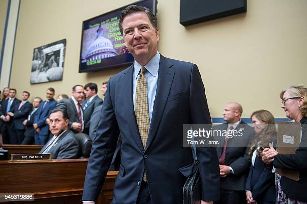 Director James Comey arrives to testify before a House Oversight and Government Reform Committee hearing in Rayburn Building on the investigation of...