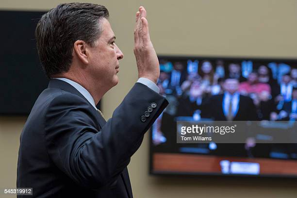 Director James Comey is sworn in before testifying at a House Oversight and Government Reform Committee hearing in Rayburn Building on the...