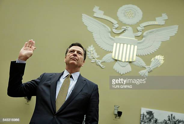 FBI Director James Comey is swornin before a House Oversight and Government Reform Committee hearing on Capitol Hill in Washington DC on July 7 2016...