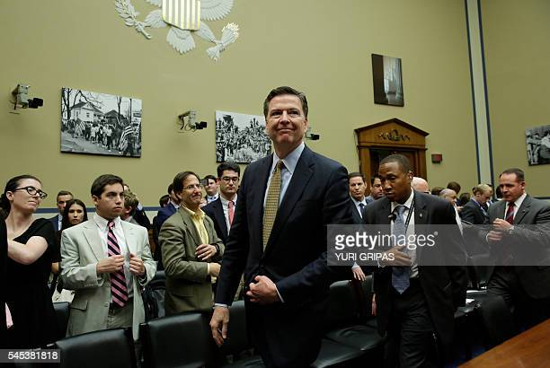 FBI Director James Comey leaves after a House Oversight and Government Reform Committee hearing on Capitol Hill in Washington DC on July 7 2016 Comey...