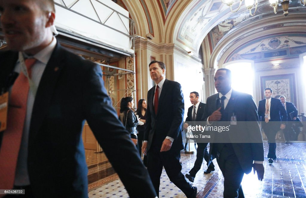 Director James Comey (C) leaves the Capitol after a meeting on Capitol Hill on February 17, 2017 in Washington, DC. Comey met with Senate members for a closed door meeting at the Capitol.