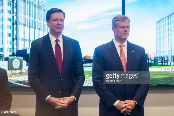 FBI director James Comey left and Massachusetts Governor Charlie Baker attend the opening of FBI Boston Headquarters on March 7 2017 in Chelsea...