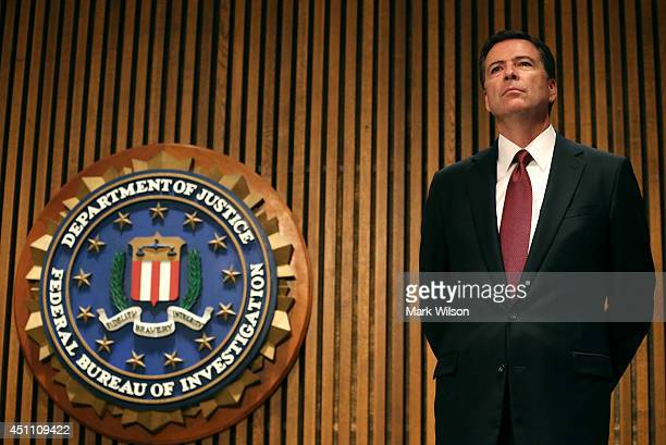 Director James Comey participates in a news conference on child sex trafficking at FBI headquarters June 23 2014 in Washington DC Director Comey said...