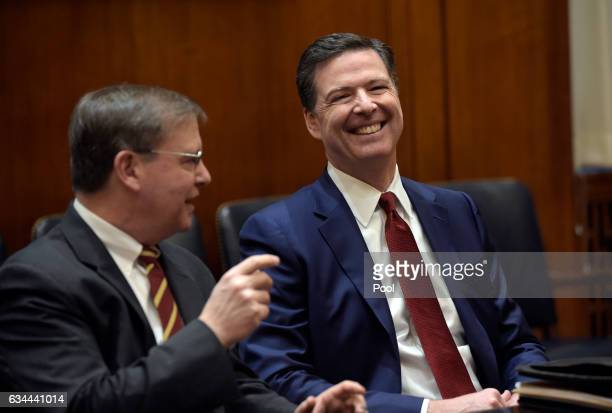 Director James Comey right shares a laugh with DEA Acting Administrator Chuck Rosenberg left as they wait for the start of a meeting with Attorney...