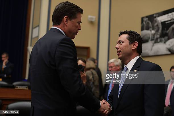 Director James Comey shakes hands with committee chairman Rep Jason Chaffetz after a hearing before House Oversight and Government Reform Committee...